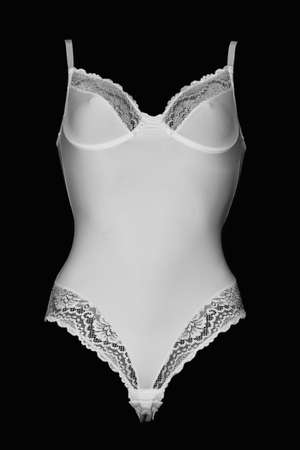 White lacy women's fashion sexy body on a black background.