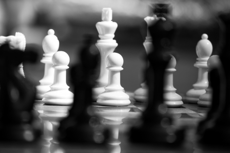 Black and white chess pieces with shallow depth of field  Abstract image  photo