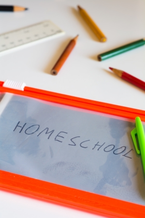 Back to school concept  Board on table with handwritten text homeschool  Stock Photo