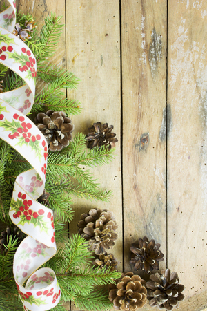 Pine branches,cones and gift ribbon Christmas concept