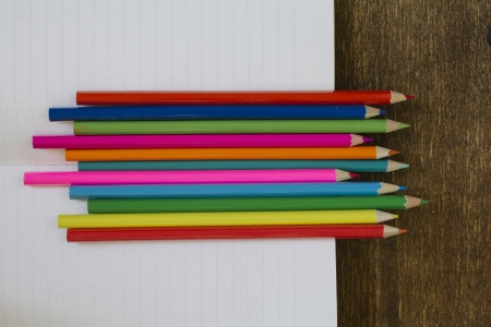 Background of pencils and notebook. photo