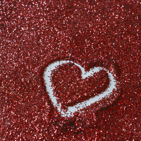 Heart shapes on glitter Stock Photo