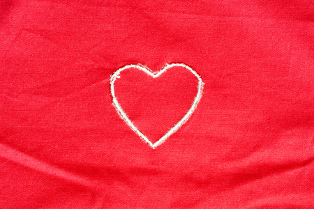 Heart embroidered handmade on red fabric