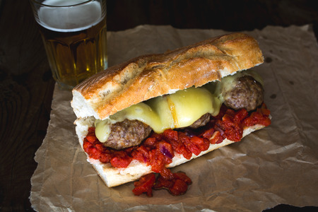 Simple meatball sub with melted scamorza cheese