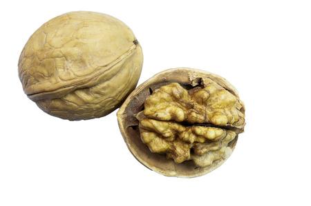Chopped walnut and whole walnut on white background