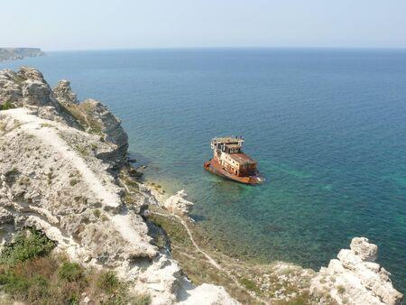 the sunken: Rusty sunken ship on the coast