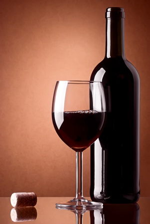 Bottle and a glass of red wine with cork photo