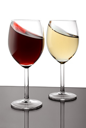 Two glasses with red and white splashed wines photo