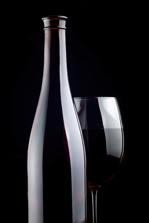Bottle and glass on a black background