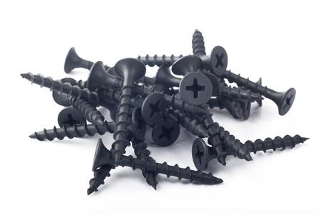the screw: Mont�n de tornillos sobre un fondo blanco Foto de archivo