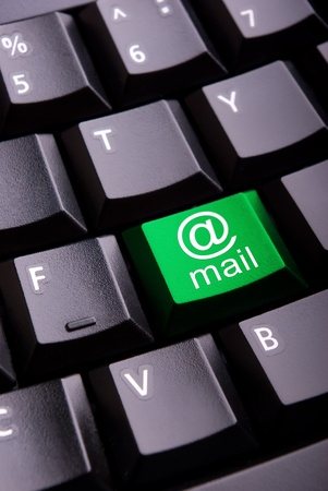 Sign of e-mail on a close-up computer button photo