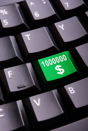 Sign of million dollars on a close-up computer button Stock Photo - 8876335