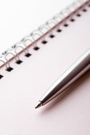 The ballpoint pen and binder of notepad photo