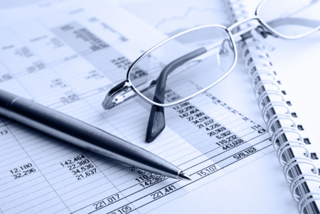 Ballpoint pen,glasses and financial report Stock Photo