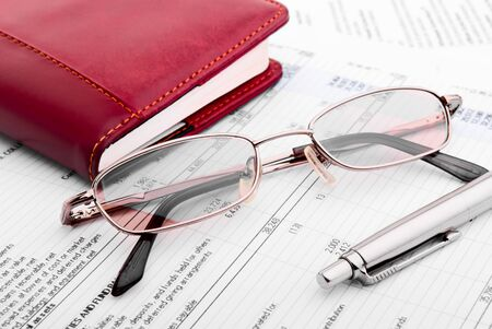 Pen,glasses and notebook close-up photo