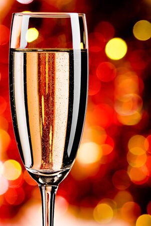 Glass with champagne and abstract color background photo