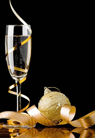 Christmas champagne with ribbon and toy ball Stock Photo