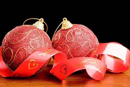 Two red christmas balls and ribbon Stock Photo