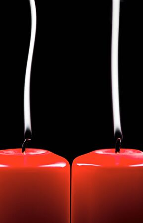 extinct: Two red extinct candles on black