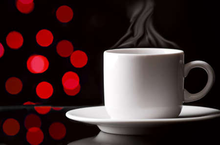 Cup of coffee on abstract color background photo