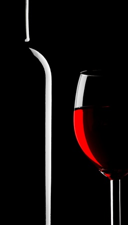 Abstract silhouette of wineglass and bottle on black