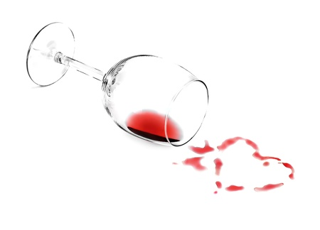 The red wine poured in the form of heart from a glass