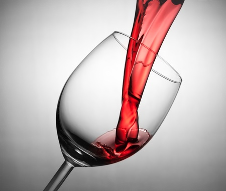 Pouring red wine in the glass photo