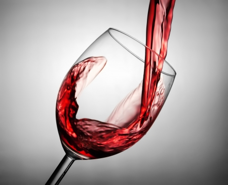 glass of red wine: Pouring red wine in the glass