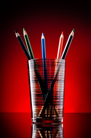 red pencil: Still- life of pencils in glass Stock Photo