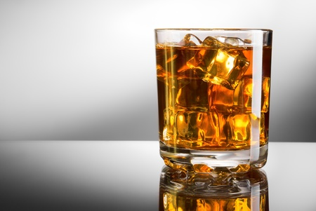 Whisky glass with ice cubes