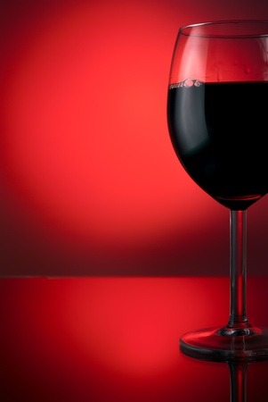 black rose: Red wine in beauty glass Stock Photo