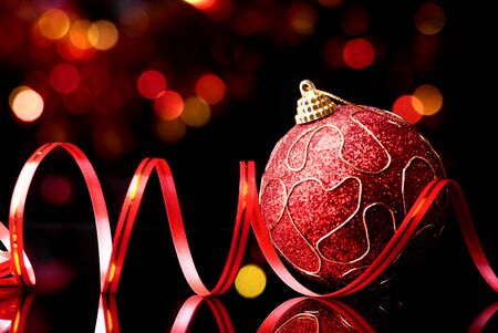 New year,christmas toy and decorative ribbon on abstract shine background photo