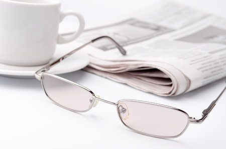 newspaper read: Morning paper with a cup of strong coffee Stock Photo