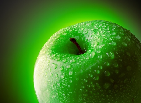 Close up of a wet green apple