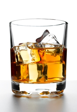 Glass of whisky with ice on a white backdrop Stock Photo