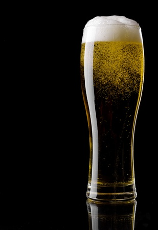 Glass of beer on a black background Stock Photo
