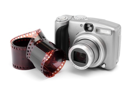 Negative film and digital photo camera on a white background photo