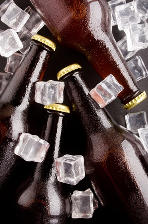 cooled: Beer bottles cooled in ice cubes