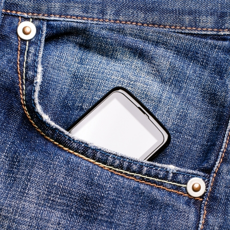 The smartphone in pocket of jeans photo