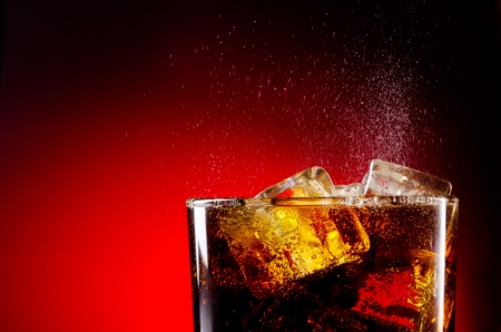 frosted glass: Ice cola with splashing CO2 bubbles