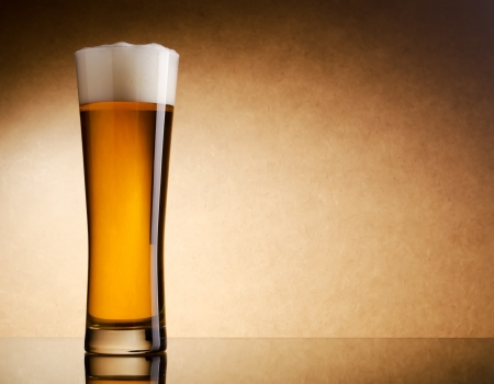 Still life photography of light beer glass photo