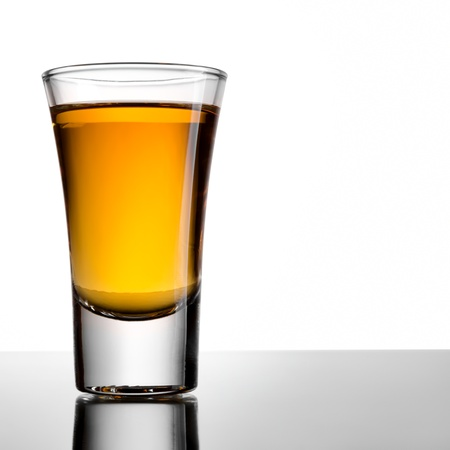 Shot of whiskey on a white background photo