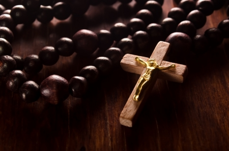 catholicism: Closeup of wooden cross and rosary