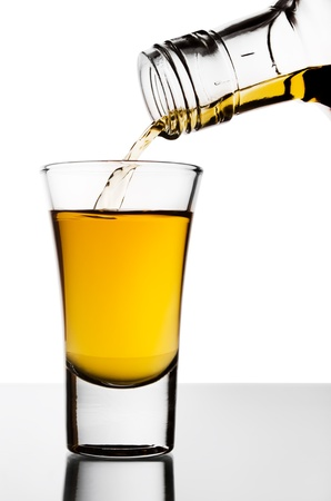 The strong alcohol flowing from a bottle Stock Photo