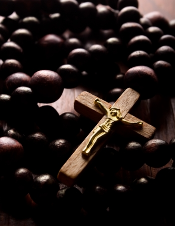 Closeup of wooden cross and rosary photo