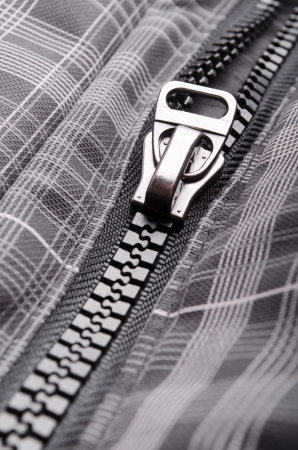 Closeup of opened clothing zipper photo