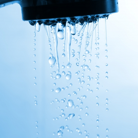 Water drops flowing from showerhead photo