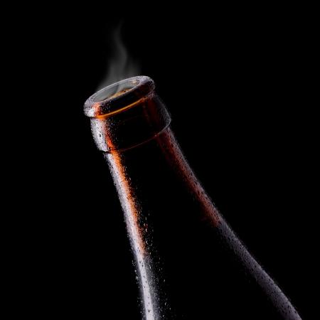 pilsner beer: Gas from open cool beer bottle