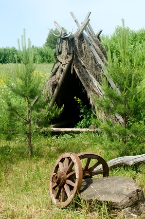 nomadic: Old wooden tent on summer meadow