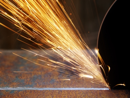 Closeup sparks from abrasive grinder circle photo